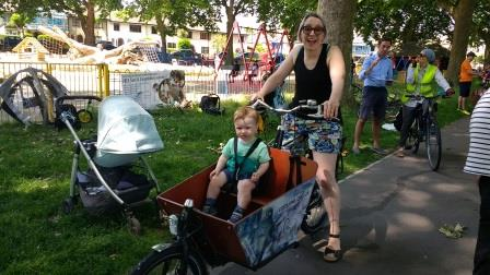 A Mum enjoying trying out a cargobike with her little son