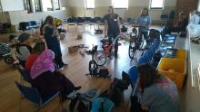 A group of parents learn more about carrying their kids by bike