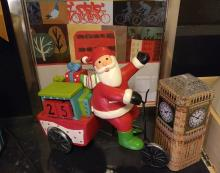 London Santa cycling on a cargobike