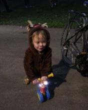Tiny tot with Christmas reindeer costume